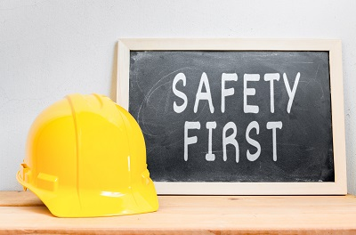 image of hard hat and a safety first sign